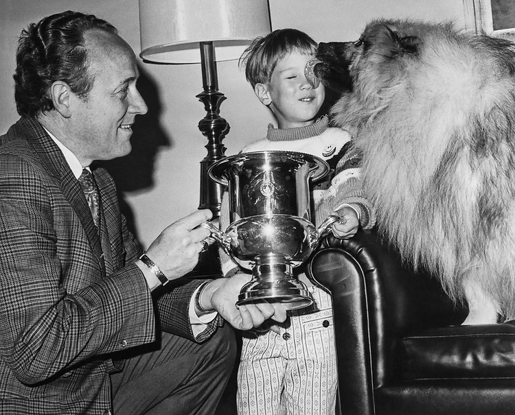 Rep. G. William Whitehurst, R-Va., gives Eric Williamson the best of breed flag for the  annual keeshond specialty. 1975 (Photo by Mickey Senko/CQ Roll Call)