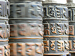 Prayer wheels at Swayambhunath Stupa. They contain cylinder contains a sacred text written or printed on paper or animal skin. Bhuddists believe spinning the wheel is the same as saying the prayers aloud.