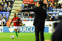 Tuesday, 7 May 2013<br /><br />Pictured: Wayne Routledge of Swansea City runs forward with the ball as Roberto Martinez, Manager of Wigan Athletic directs his players on the field<br /><br />Re: Barclays Premier League Wigan Athletic v Swansea City FC  at the DW Stadium, Wigan