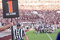 Game Day: MSU Football versus South Carolina.<br /> Kicking into the goal with official looking<br />  (photo by Robert Lewis / &copy; Mississippi State University)