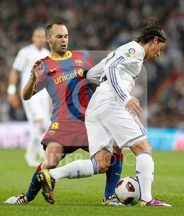 Real Madrid's Andres Iniesta and FC Barcelona's Mesut Ozil during la Liga match on April 16th 2011...Photo: Cesar Cebolla / ALFAQUI