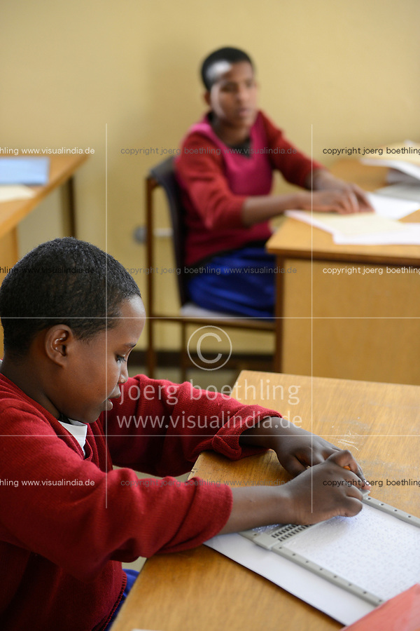 ETHIOPIA, Amhara, Gondar, school for blind children, writing braille letters / AETHIOPIEN, Amhara, Gonder, Schule fuer blinde Kinder, Blindenschrift schreiben, blinder Junge Smegnew Tigist, 12 Jahre