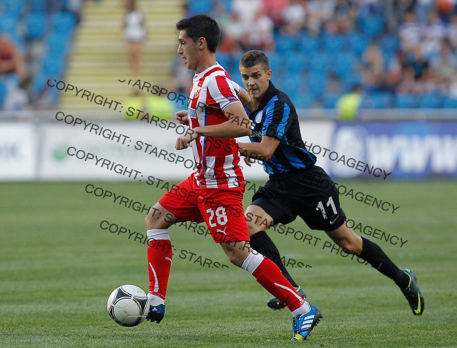 Fudbal UEFA Europa League season 2013-2014<br /> Cernomorec Vs. Crvena Zvezda<br /> Vukan Savicevic left and Ivan Bobko<br /> Odessa, 02.08.2013.<br /> foto: Srdjan Stevanovic/Starsportphoto &copy;