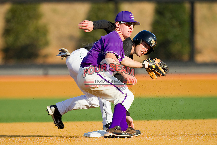 Steven Brooks #1 of the Wake Forest Demon Deacons steals second base ahead of the tag by Ross Hefley #2 of the Western Carolina Catamounts at Gene Hooks Field on February 22, 2011 in Winston-Salem, North Carolina.  Photo by Brian Westerholt / Four Seam Images