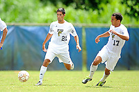 2 October 2011:  FIU midfielder/forward Christopher Garces (21) passes the ball in the first half as the FIU Golden Panthers defeated the University of Kentucky Wildcats, 1-0 in overtime, at University Park Stadium in Miami, Florida.