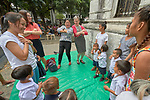 Harriett Olson (in red sweater), the chief executive officer of United Methodist Women, sings and dances with a group of children in the Manila North Cemetery in Manila, Philippines, on January 16, 2018. Olson was in the Philippines to meet with women from throughout the region. United Methodist Women has long supported educational and other work in the cemetery carried out by the Kapatiran-Kaunlaran Foundation (KKFI).