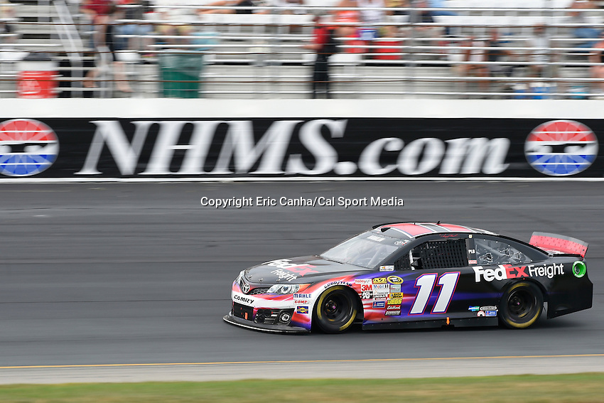 July 13, 2014 - Loudon, New Hampshire, U.S. - Sprint Cup Series driver Denny Hamlin (11) races into turn 4 during the NASCAR Sprint Cup Series Camping World RV 301 race held at the New Hampshire Motor Speedway in Loudon, New Hampshire. Eric Canha/CSM