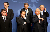 President Silvio Berlusconi of Italy, bottom center, waits to take a group photo with the heads of delegations attending the Nuclear Security Summit at the Washington Convention Center in Washington, D.C., U.S., on Tuesday, April 13, 2010. Ukraine's agreement to relinquish its entire stockpile of highly enriched uranium gave Obama the first concrete result for a summit he convened on securing the world's atomic material. .Credit: Andrew Harrer / Pool via CNP