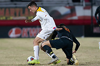 COLLEGE PARK, MD - NOVEMBER 21: Tomas Jamett #17 of Iona dribbles away from Malcolm Johnson #11 of Maryland during a game between Iona College and University of Maryland at Ludwig Field on November 21, 2019 in College Park, Maryland.