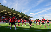 Lincoln City's lead sports scientist Luke Jelly leads the Lincoln City players during the pre-match warm-up<br /> <br /> Photographer Chris Vaughan/CameraSport<br /> <br /> The EFL Sky Bet League Two - Lincoln City v Swindon Town - Saturday 11th August 2018 - Sincil Bank - Lincoln<br /> <br /> World Copyright &copy; 2018 CameraSport. All rights reserved. 43 Linden Ave. Countesthorpe. Leicester. England. LE8 5PG - Tel: +44 (0) 116 277 4147 - admin@camerasport.com - www.camerasport.com