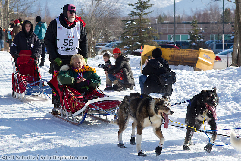 David Sawatzky and team run past spectators on the bike/ski trail during the Anchorage ceremonial start during the 2013 Iditarod race.    Photo by Britt Coon/IditarodPhotos.com