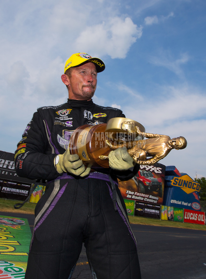 Sep 7, 2015; Clermont, IN, USA; NHRA funny car driver Jack Beckman celebrates after winning the US Nationals at Lucas Oil Raceway. Mandatory Credit: Mark J. Rebilas-USA TODAY Sports