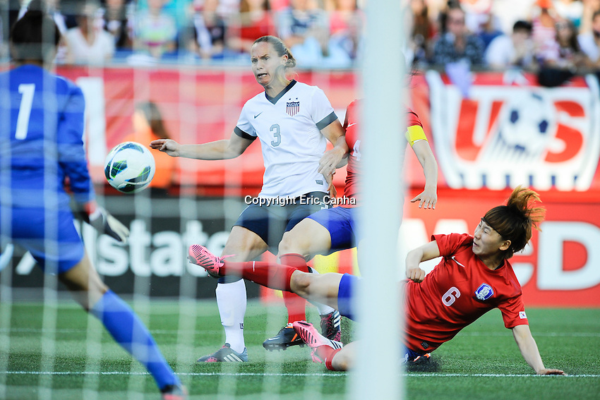 Korea Republic defender Lim Seonjoo (6) makes a diving save and strips the ball from US Women's National defender Christie Rampone (3) during the International Friendly soccer match between the USA Women's National team and the Korea Republic Women's Team held at Gillette Stadium in Foxborough Massachusetts.   Eric Canha/CSM