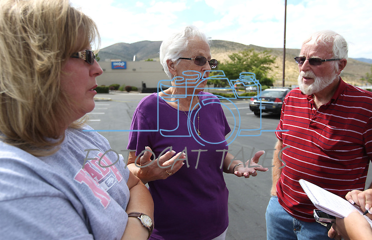 Witnesses, from left, Kathy Chaney and her parents Ethlyn and Howard MacDonald talk outside the IHOP restaurant in Carson City, Nev., on Wednesday, Sept. 7, 2011. They were in the restaurant Tuesday when gunman Eduardo Sencion opened fire with an AK-47, killing four people and injuring seven others. (AP Photo/Cathleen Allison)