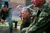 Young soldiers smoke during a break at the military base in Bartoszyce. This year's class of drafted recruits is the final one after 90 years of compulsory military service, as Poland's army turns professional in 2009.