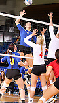 BROOKINGS, SD - OCTOBER 5:  Tiara Gibson #7 from South Dakota State University tries to get a kill past Audrey Reeg #4 from the University of South Dakota in the fourth game of their match Saturday night at Frost Arena. (Photo by Dave Eggen/Inertia)