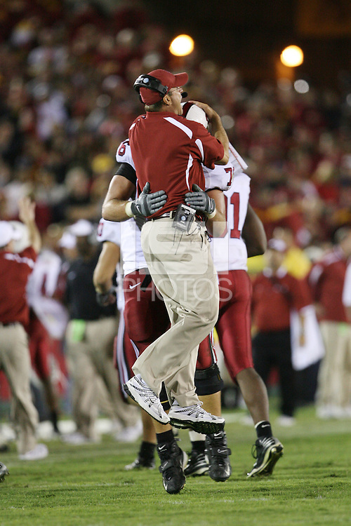 6 October 2007: Jim Harbaugh celebrates with Ben Muth after Stanford scores the go ahead touchdown of Stanford's 24-23 win over the #1 ranked USC Trojans in the Los Angeles Coliseum in Los Angeles, CA.