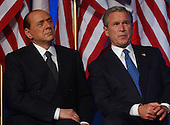 Washington, D.C. - May 19, 2004 -- United States President George W. Bush and Prime Minister Silvio Berlusconi appear together at the 16th Annual Sons of Italy Gala Award Dinner in Washington, D.C. on May 19, 2004.  .Credit: Ron Sachs - Pool via CNP.