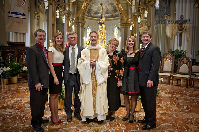 Rev. Kevin Grove, C.S.C. poses with family after his ordination in the Basilica of the Sacred Heart April 10, 2010...Photo by Matt Cashore/University of Notre Dame