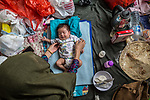 28 August 2019, Jakarta, Indonesia: - Afghan baby Mehran, just 40 days old, with her mother, Khadija Hussani (31),inside their shared room at the UNHCR refugee centre in Kalideres, Jakarta.Plans to re-locate the overcrowded refugees have been fast tracked after a fight broke out between the groups, many of whom have been in Indonesia for years waiting for placement. Tensions ran high between Afghan and African groups in the centre with a lack of adequate food for the refugees being the catalyst. The African groups, who were moved onto the footpath, were being bussed out today. Conditions in the centre are grim and the local Indonesian population not happy with the refugees presence in the suburb.Picture by Graham Crouch/The Australian