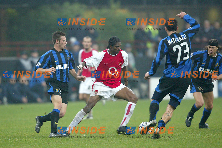 MILANO 25/11/2003 <br /> Champions League Inter Arsenal 1-5<br /> Kanu (Arsenal) tra Giovanni Pasquale (left) e Marco Materazzi (Right) (Inter)<br /> Kanu (Arsenal) between Giovanni Pasquale (left) and  Marco Materazzi (Right) (Inter)<br /> Photo Andrea Staccioli Insidefoto