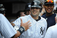 New York Yankees DH Jesus Montero #63 hits his first major league home run against the Baltimore Orioles pitcher Jim Johnson (not shown) during the 5th inning at Yankee Stadium on September 5, 2011 in Bronx, NY.  Yankees defeated Orioles 11-10.  Tomasso DeRosa/Four Seam Images