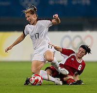 USWNT midfielder (17) Lori Chalupny is fouled by Canadian midfielder (8) Diana Matheson while playing at Shanghai Stadium.  The US defeated Canada, 2-1, in extra time and advanced to the semifinals during the 2008 Beijing Olympics in Shanghai, China.