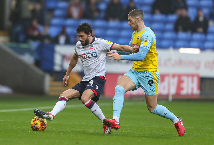 Bolton Wanderers' Jason Lowe competing with Rotherham United's Jamie Proctor<br /> <br /> Photographer Andrew Kearns/CameraSport<br /> <br /> The EFL Sky Bet Championship - Bolton Wanderers v Rotherham United - Wednesday 26th December 2018 - University of Bolton Stadium - Bolton<br /> <br /> World Copyright © 2018 CameraSport. All rights reserved. 43 Linden Ave. Countesthorpe. Leicester. England. LE8 5PG - Tel: +44 (0) 116 277 4147 - admin@camerasport.com - www.camerasport.com