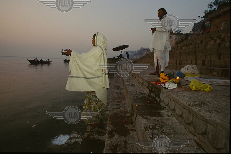 Radha, a low caste Hindu priestess, worships at the River Ganges.
