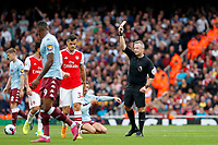 Referee, Jonathan Moss cautions Granit Xhaka of Arsenal during the Premier League match between Arsenal and Aston Villa at the Emirates Stadium, London, England on 22 September 2019. Photo by Carlton Myrie / PRiME Media Images.