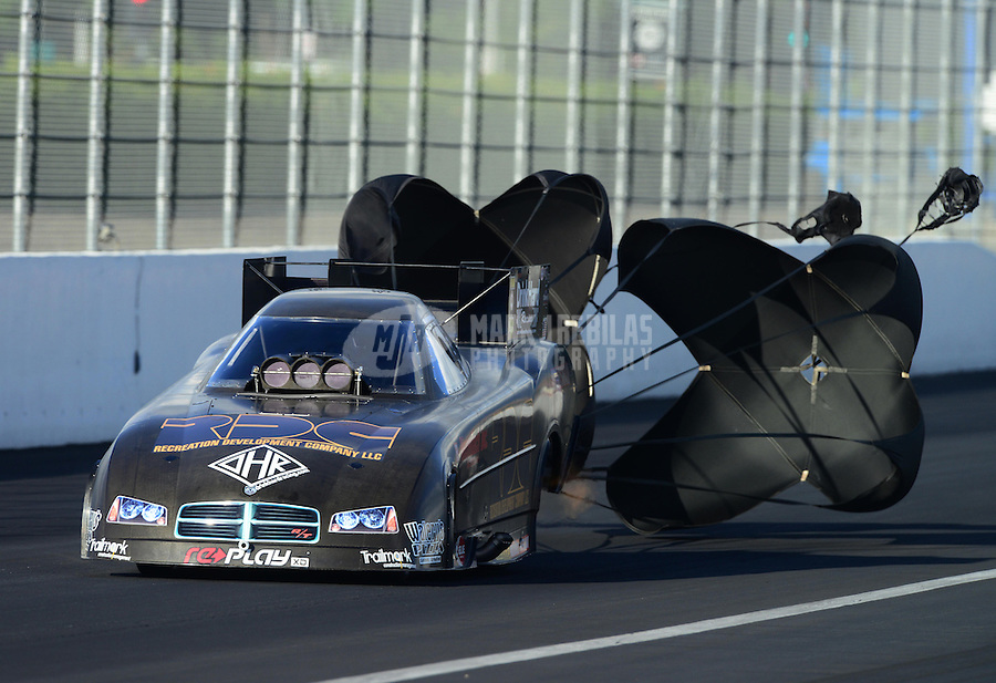 Nov. 9, 2012; Pomona, CA, USA: NHRA funny car driver Grant Downing during qualifying for the Auto Club Finals at at Auto Club Raceway at Pomona. Mandatory Credit: Mark J. Rebilas-
