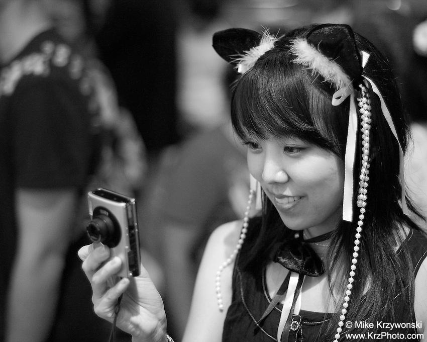 Japanese girl looking at her camera on Halloween in Waikiki, Honolulu, Oahu, Hawaii