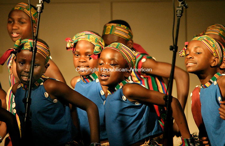 NAUGATUCK, CT - 17 JUNE 2005 -061705JS04--Members of the African Children's Choir performed during a concert Friday at the Hillside Covenant Church in Naugatuck. The grammy-nominated group, selected from thousand orphans and disadvantaged children in Africa, has dedicated its current tour to helping children who have lost one of both parents to AIDS or other diseases.  --Jim Shannon Photo--African Children's Choir, Hillside Covenant Church,  Naugatuck are CQ