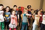 Education Elementary School New York Grade 2 arts enrichment music children singing and gesturing during chorus class horizontal