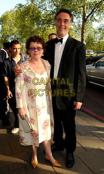 IMELDA STAUNTON & GREG WISE.The British Academy TV Craft Awards, Dorchester hotel, London, England..May 11th, 2008.BAFTA full length black tuxedo white cream floral print dress pink tinted glasses .CAP/CAN.©Can Nguyen/Capital Pictures.