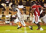 Inglewood, CA 10/09/14 - Nick Orlando (Peninsula #15) and unidentified Morningside player(s) in action during the Palos Verdes Peninsula vs Morningside CIF Varsity football game at Coleman Field in Inglewood.  Peninsula defeated Morningside 24-13.