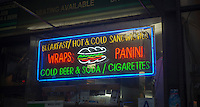 An illuminated sign for a delicatessen in New York on Wednesday, January 30, 2013. (© Richard B. Levine)