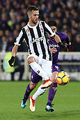 9th February 2018, Stadio Artemio Franchi, Florence, Italy; Serie A football, ACF Fiorentina versus Juventus;  Miralem Pjanic of Juventus is pressured by Giovanni Simeone of Fiorentina