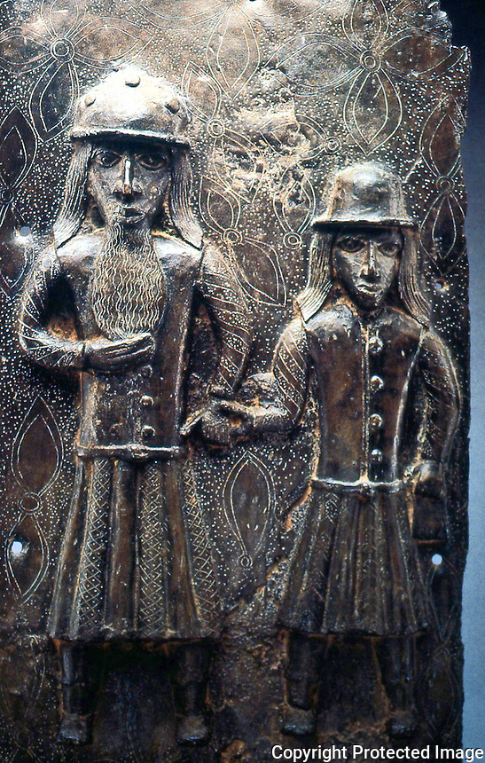 "World Civilization:  Benin--Plaque of Two Portuguese, 16th -17th C.  20 1/2 "" brass."