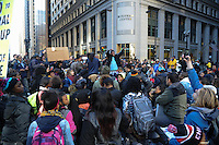 Protesters calling on Chicago Mayor Rahm Emanuel to resign stage a sit in in front of City Hall at the intersection of Washington and Clark Street in the Loop in Chicago, Illinois on December 9, 2015.  Emanuel offered a historic apology for the police killing of Laquan McDonald and police brutality and racial profiling generally -- without using those words -- in front of the City Council in the morning.