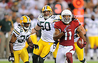 Aug. 28, 2009; Glendale, AZ, USA; Arizona Cardinals wide receiver (11) Larry Fitzgerald runs the ball in the first half against the Green Bay Packers during a preseason game at University of Phoenix Stadium. Mandatory Credit: Mark J. Rebilas-