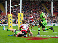 Northampton Saints' Harry Mallinder evades the tackle of Gloucester Rugby's Henry Purdy scores his sides second try <br /> <br /> Photographer Ashley Western/CameraSport<br /> <br /> Aviva Premiership - Gloucester v Northampton Saints - Saturday 7th October 2017 - Kingsholm Stadium - Gloucester<br /> <br /> World Copyright &copy; 2017 CameraSport. All rights reserved. 43 Linden Ave. Countesthorpe. Leicester. England. LE8 5PG - Tel: +44 (0) 116 277 4147 - admin@camerasport.com - www.camerasport.com