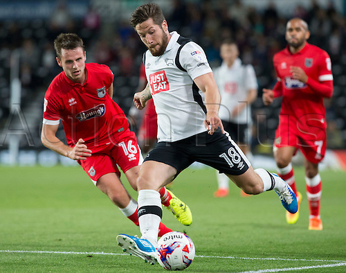 09.08.2016. iPro Stadium, Derby, England. Football League Cup 1st Round. Derby versus Grimsby Town. Derby County midfielder Jacob Butterfield prepares to pass the ball under pressure from Grismby Town's James Berrett.