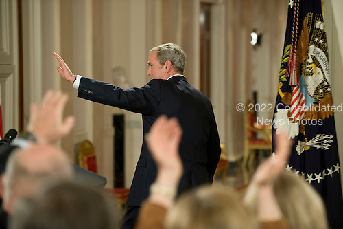 Washington, DC - January 15, 2009 -- United States President George W. Bush waves after delivering his farewell speech to the Nation from the East Room of the White House in Washington, D.C., Thursday, January 15, 2009..Credit: Mannie Garcia - Pool via CNP