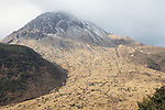Mount Unzen Volcano with lava dome formed during the 1990-1995 eruption, Japan. The treeless slope signifies the path of extensive pyroclastic flows during the eruptions.