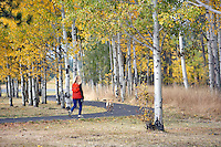 lady walking dog on path at Black Butte Ranch. Oregon