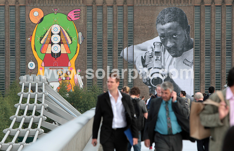 **ALL ROUND PICTURES FROM SOLARPIX.COM**.**NO UK NEWSPAPER PUBLICATION **UK MAGAZINE & SUPPLEMENT PUBLICATION ONLY** AND NO PUBLICATION IN FRANCE, SCANDINAVIA, AUSTRALIA AND GERMANY** .Six internationally acclaimed Street artists have created giant artworks for the first commission to use the facade of Tate Modern Art Museum in London. Each image towers 15 metres high on the front of Tate Modern and has transformed the river view of this iconic building. The artists include JR from France and Brazil and Sixeart from Spain...JOB REF: 6498 SFE       DATE: 23_05_2008.**MUST CREDIT SOLARPIX.COM OR DOUBLE FEE WILL BE CHARGED* *UNDER NO CIRCUMSTANCES IS THIS IMAGE TO BE REPRODUCED FOR ANY ONLINE EDITION WITHOUT PRIOR PERMISSION*