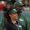 Collette Smith, New York Jets assistant defensive coach, and head coach Todd Bowles enter the field during the team's annual Green & White practice and scrimmage at MetLife Stadium in East Rutherford, NJ on Saturday, Aug. 5, 2017.