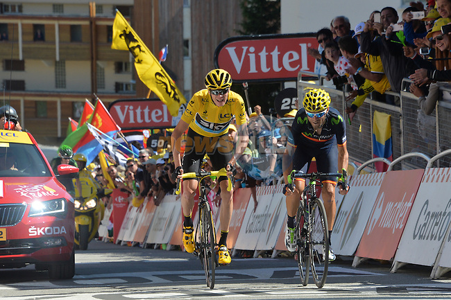 Race leader Christopher Froome (GBR) Team Sky and Alejandro Valverde (ESP) Movistar cross the finish line at the end of Stage 20 of the 2015 Tour de France running 110.5km from Modane Valfrejus to Alpe d'Huez, France. 25th July 2015.<br /> Photo: ASO/G.Demouveaux/Newsfile