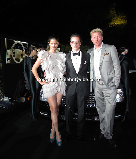 Shermine Shahrivar, Maybach CEO Patrick Marinoff and Boris Becker..De Grisogno Party..2011 Cannes Film Festival..Eden Roc Restaurant at Hotel Du Cap..Cap D'Antibes, France..Tuesday, May 17, 2011..Photo By CelebrityVibe.com..To license this image please call (212) 410 5354; or.Email: CelebrityVibe@gmail.com ;.website: www.CelebrityVibe.com